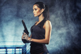 picture of raider  - sexy brutal woman standing on factory ruins and holding handgun - JPG
