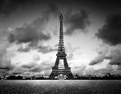 Artistic image of Effel Tower, Paris, France. Black and white, vintage mood with dramatic sky.