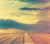 sunset sky and wood floor, filtered background image, retro film filtered, instagram style