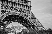 Foot of the Eiffel Tower in black and white