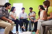 Group Of Hispanic Designers Meeting To Discuss New Ideas