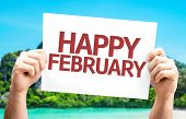 Happy February card with a beach on background