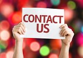 Contact Us card with colorful background with defocused lights