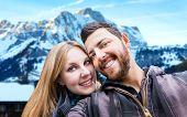 Beautiful Couple taking a selfie photo in Switzerland