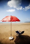 Sun bed and red beach umbrella