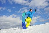 young man take fun on the snowboard