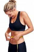 Woman taking waist measurement with tape for thin weightloss healthy slimming diet isolated
