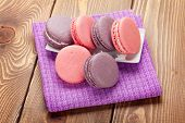 Colorful macaron cookies on wooden table background