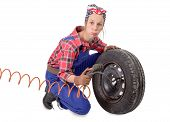 Vintage And Young Woman Inflates A Car Tire