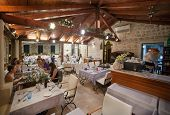 DUBROVNIK, CROATIA - MAY 27, 2014: Guests having dinner at restaurant's terrace. Dubrovnik has many restaurants which offer traditional Dalmatian cuisine and some great wine lists.
