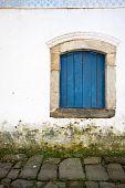Blue window over walkway - Paraty, Brazil
