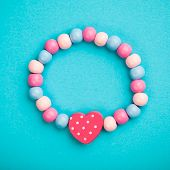 toy bracelet with heart shape, blue background