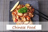 pic of chinese parsley  - Chinese noodles with vegetables on plate on bamboo mat background and space for your text - JPG