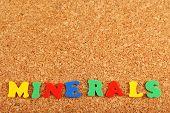 Minerals word on cork board background