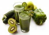 Green fresh healthy juice with fruits and vegetables isolated on white background