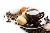 Gentle colorful macaroons and black coffee in mug isolated on white