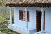 Old Traditional Moldavian House With Roof Covered With The Dry Rush