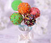 stock photo of cake pop  - Sweet cake pops in vase on table on light background - JPG