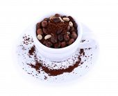 Cup of coffee beans isolated on white