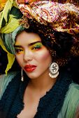 beauty bright woman with creative make up, many shawls on head l