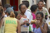 People eat local street fast food in Havana, Cuba.