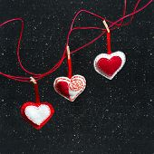 Three Hearts Of Fabric On A Black Background. Symbol Of Love.