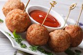 Fried Meatballs On Skewers And Tomato Sauce, Horizontal
