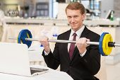 picture of toothless smile  - Smiling young red hair man in formalwear sitting at the restaurant and holding a dumbbell - JPG