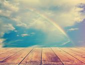 rainbow, sunset sky and wooden floor, background, retro film filtered, instagram style