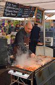 Man Cooking Kebabs At The Rocks Saturday Morning Market