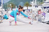 stock photo of marina  - woman jogging at early morning with yacht boats in marina - JPG