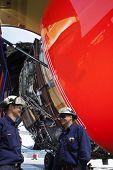 mechanics, engineers and large jumbo jet engine turbine