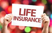 Life Insurance card with colorful background with defocused lights