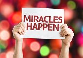 Miracles Happen card with colorful background with defocused lights