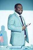 Happy African-american employee in elegant suit