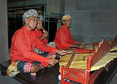 Gamelan Jegog Trio Performing In Bali, Indonesia.