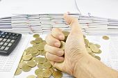 Gold Coins In Hand On Finance Account