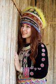 picture of hmong  - Traditionally dressed Mhong hill tribe woman in the wooden cottage - JPG