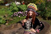 pic of hmong  - Traditionally dressed Mhong hill tribe woman in the garden at mountain - JPG