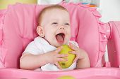 Happy Baby Eating Apple