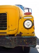 Old yellow school bus with chipped paint and rust