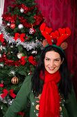 Woman With Reindeer Ears And Xmas Tree