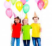 Portrait of three cute little girls with bright balloons - isolated on a white.