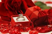 Red hearts and rose with wedding ring