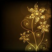 Golden and shiny floral design on brown background.