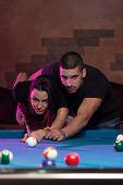 Beautiful Couple Playing Pool