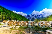 picture of jade blue  - A view of a river and Jade Dragon Snow Mountain in Lijiang  - JPG