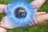 United Children's Hands Holding A Globe.