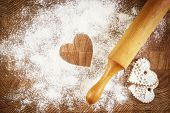 pic of home is where your heart is  - Heart of white flour on a wooden board - JPG