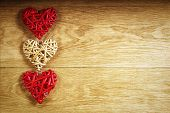 Three beautiful romantic vintage hearts on a wooden oak background. Love and St. Valentines Day concept.